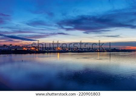 Panorama of Belgrade at night with river Danube - stock photo