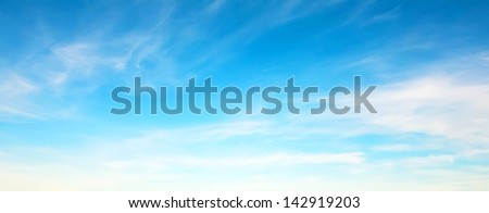 Panorama of blue sky with white clouds in clear weather on a sunny day - stock photo