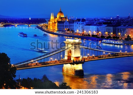 Panorama of Budapest, Hungary, with Danube river,  Chain Bridge and the Parliament at blue hour - stock photo