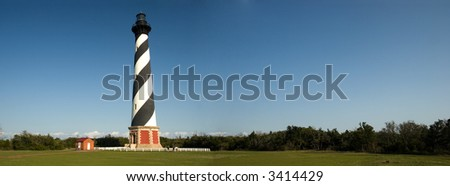 Panorama of Cape Hatteras Lighthouse   Black & White Brick, Spiral-Striped Lighthouse Built in 1869-1870   Outer Banks, North Carolina - stock photo