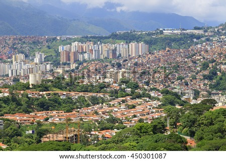 Panorama of Caracas city, capital city of Venezuela. Slums are seen on the hillside. - stock photo
