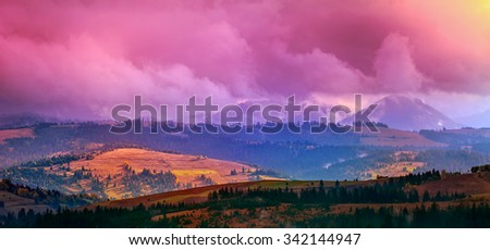 Panorama of Carpathian mountain range with colorful sunset sky. Landscape in autumn season - stock photo