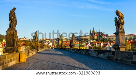 Panorama of Charles bridge and Prague castle in the early morning. Prague, Czech Republic - stock photo