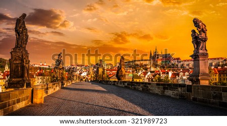 Panorama of Charles bridge with statues and Prague castle on surise. Prague, Czech Republic - stock photo