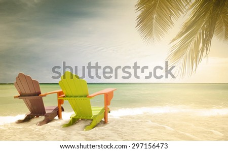 Panorama of colorful lounge chairs at a tropical paradise beach in Miami Florida, desaturated vintage instagram filter for retro looks - stock photo
