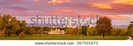 Panorama of Denver Colorado skyline from City Park with City Park Boathouse and Rocky Mountains in background on autumn morning - stock photo