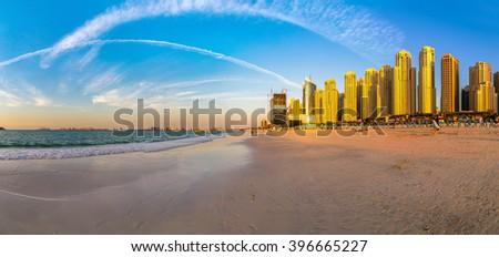 Panorama of Dubai marina in the summer evening, sunset, UAE - stock photo