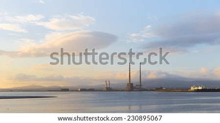 Panorama of Dublin Bay with Poolbeg station and a ferry - stock photo