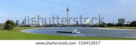 Panorama of Dusseldorf with Rheinturm TV tower from the bend of Rhine river, Germany - stock photo
