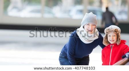 panorama of family enjoying ice skating at outdoor skating rink, winter holiday or vacation activity - stock photo