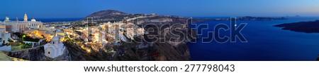 Panorama of Fira and volcanic caldera at twilight, Santorini (Thira), Cyclades islands, Greece - stock photo