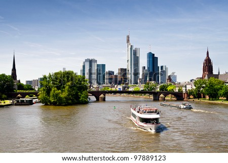 Panorama of Frankfurt with tourist boats on the river - stock photo