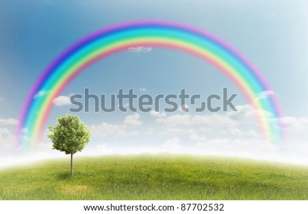 panorama of green field with a tree on blue sky background - stock photo