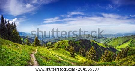 Panorama of green hills in Zaili Alatau mountains, Almaty, Kazakhstan - stock photo