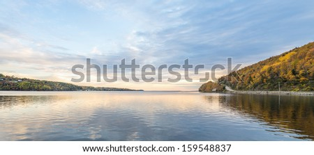 Panorama of harbour in the autumn with reflections of clouds - stock photo