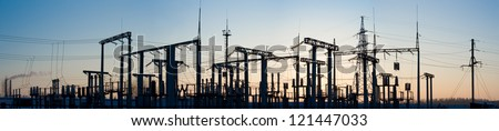 Panorama of high-voltage substation.Silhouette of high-voltage substation at sunset. - stock photo