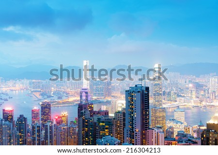 Panorama of Hong Kong skyline at night from Victoria Peak - stock photo
