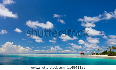 Panorama of idyllic island and turquoise ocean water - stock photo