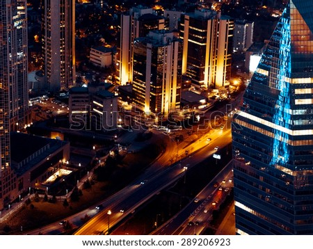 Panorama of Istanbul aerial view at night with office building and skyscrapers. Nightlife in Istanbul, evening illumination, top view of the city. Modern townscape with night streets. - stock photo
