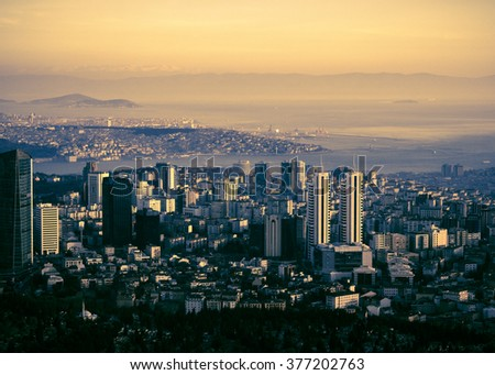 Panorama of Istanbul city - skyscrapers and shoreline of Bosporus, cityscape on sunset. Panoramic view of Istanbul - top view on modern town, seaport and Princes Islands at horizon. - stock photo