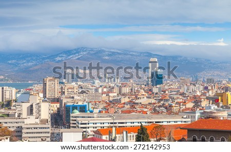 Panorama of Izmir city, Turkey. Modern buildings and mountains on a horizon - stock photo