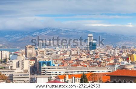 Panorama of Izmir city, Turkey. Modern buildings and mountains on a horizon - stock photo