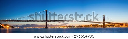 Panorama of Lisbon cityscape with 25 de Abril suspension Bridge, Portugal at dusk - stock photo
