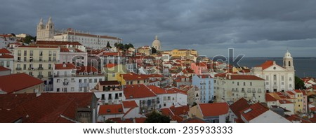 Panorama of Lisbon with a cloudy sky - stock photo