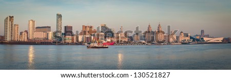 Panorama of Liverpool with Mersey Ferry - stock photo
