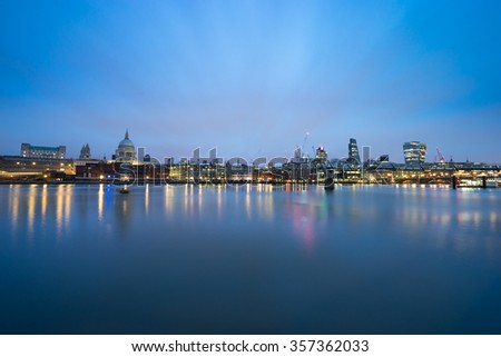 Panorama of London,Southwark bridge and St.Paul's cathedral viewed at sunrise - stock photo