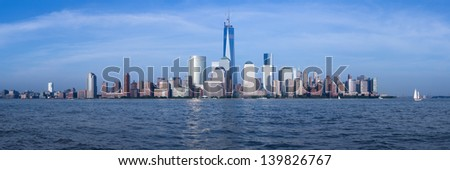 Panorama of lower Manhattan of New York City from Exchange Place at dusk with World Trade Center at full height of 1776 feet May 2013 - stock photo