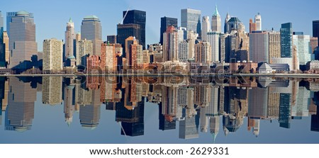 Panorama of Manhattan skyline with water reflection - stock photo