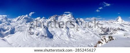 Panorama of Matterhorn snow mountains on a clear sunny day, Zermatt, Switzerland - stock photo