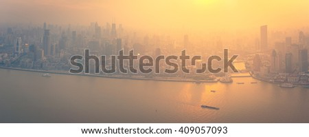 Panorama of modern megalopolis city at sunset, Shanghai  skyline.  - stock photo