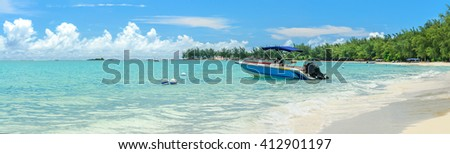 Panorama of Mont Choosy beach in Mauritius with a taxi speedboat - stock photo