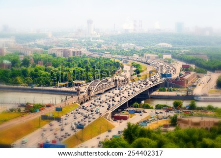 Panorama of Moscow in the haze, Russia. Highway with cars, Moscow river. - stock photo