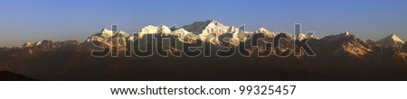 Panorama of Mount Kanchenjunga from Tiger Hill Darjeeling at sunrise. - stock photo