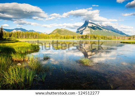 Panorama of Mount Rundle mountain peak with blue sky reflecting in Vermilion Lakes at Banff national park, Alberta Canada - stock photo