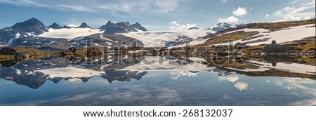 panorama of mountains and lakes in the norwegian national park  - stock photo
