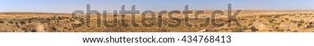 Panorama of mountains in Negev desert in Israel with road - stock photo