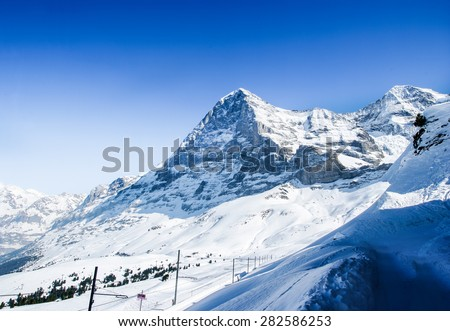 Panorama of mountains in the Bernese Oberland with the famous north face of mount Eiger.  - stock photo