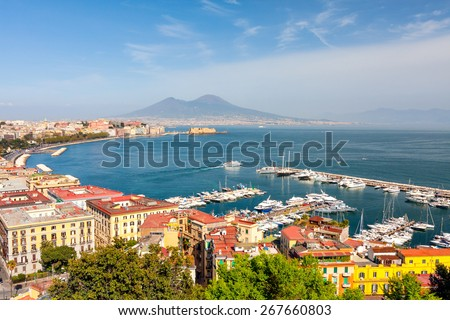 Panorama of Naples with Mount Vesuvius and the Bay. View from a high point. The coastal part of Naples, piers with yachts. Beautiful bay with views of Mount Vesuvius in summer sunny day. - stock photo