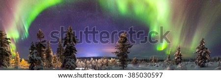 Panorama of northern lights over Lapland, Finland. - stock photo