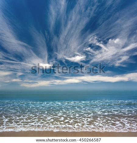 panorama of ocean wet sandy shore beach - stock photo