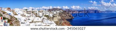 Panorama of Oia village on Santorini island in Greece - stock photo