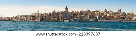 panorama of old districts Istanbul (Karakoy, Galata) from the Bosphorus on a sunny day on background blue sky - stock photo