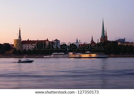 Panorama of old Riga at dusk. Latvia - stock photo