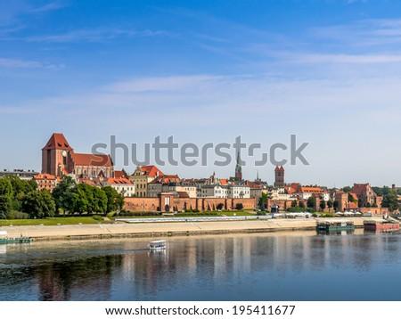 Panorama of old town Torun over the Vistula river, Poland - stock photo