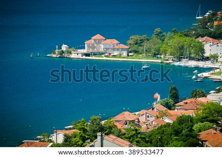 Panorama of old town with red sloped roofs of Kotor. Old town of Kotor and Boka Kotorska bay in Montenegro - stock photo