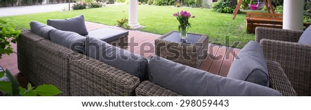 Panorama of patio with comfortable garden furniture - stock photo